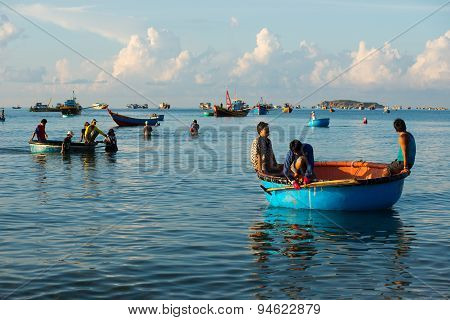 Unidentified fishermen works on the beach in Binhthuan, Vietnam
