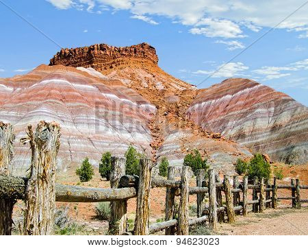 Rustic Fence And Colorful Cliffs