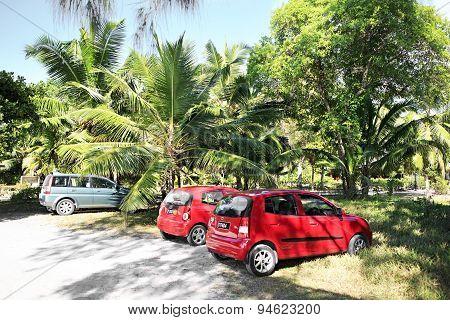 Car parking on the beach Anse Lazio.