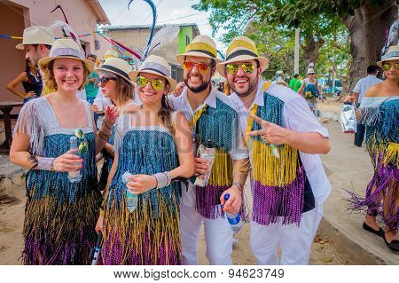 Caucasian and Colombian performers with colorful and straw hats participate in Colombia's most impor