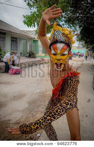 Performer dressed in jaguar skin costume and face paint part of the El Tigrillo group that participa