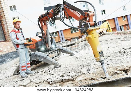 builder worker in safety protective equipment operating construction demolition machine robot. Focus on tool