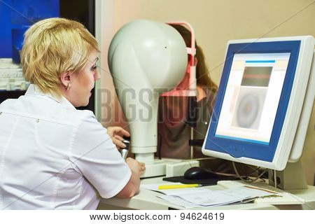 Optometry concept. female optometrist optician doctor evaluate eyesight of female patient in eye ophthalmological clinic