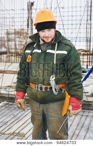 concrete worker. positive foreman in front of concrete reinforcement during construction formwork for concreting at building area