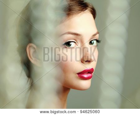 A beautiful woman, portrait isolated on grey background