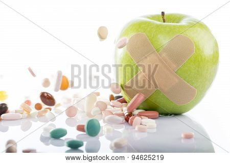 Green apple with various pills
