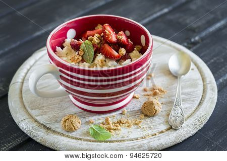 Cottage Cheese With Strawberries And Biscuits On A Dark Wooden Background