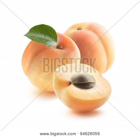 Two Whole Apricots And Half With Seed Isolated