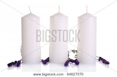 Lavender flowers with candles isolated on white