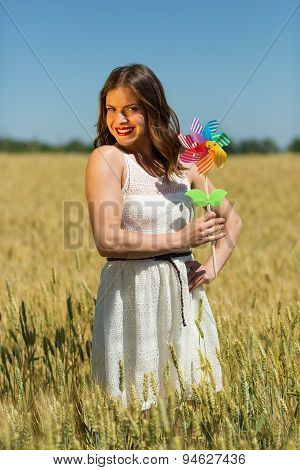 Happy Girl With A Colorful Windmill
