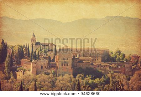 View of the Alhambra from the Albayzin of Granada,  Andalusia, Spain. Photo in retro style.  Added  paper texture.