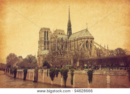 Notre Dame de Paris. View from the south. Photo in retro style. Added paper texture.