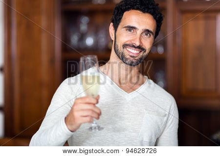 Man drinking champagne in his living room