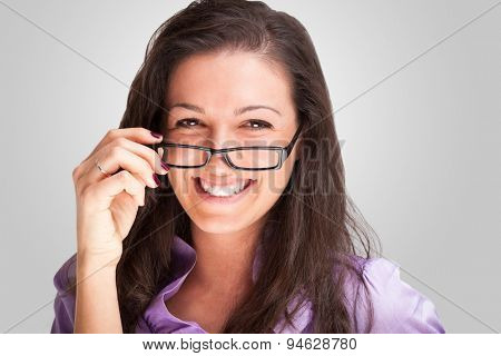 Portrait of a young woman holding her eyeglasses