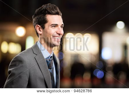 Portrait of a businessman walking in a city in the night