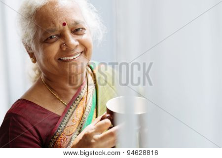 Indian Woman With A Mug