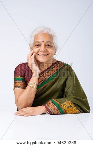 Indian Woman At The Table