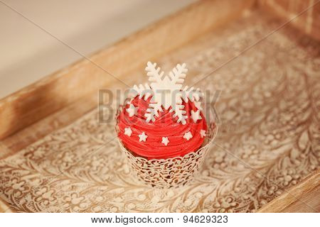 Red Cupcake On Wooden Plate