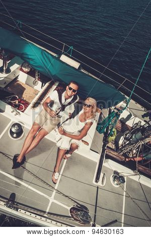 Stylish wealthy couple on a yacht