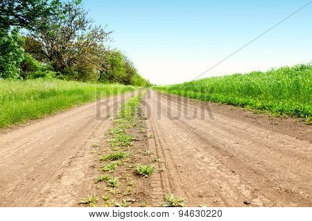 Country road over blue sky background
