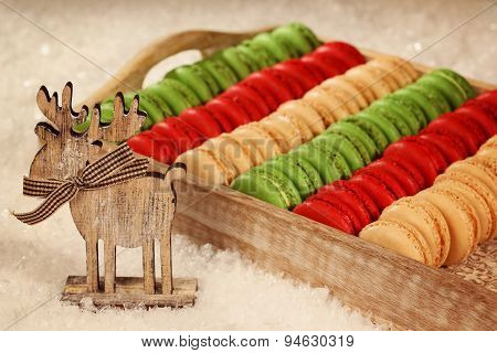 Red And Green Macaroons On Wooden Plate
