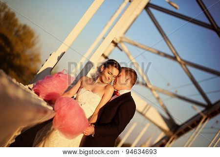 Bride And Groom Holding A Candy Floss
