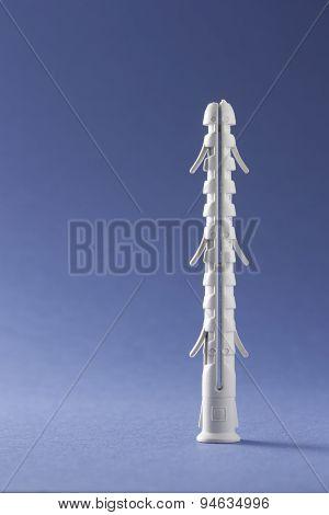 Plastic Straddling Dowel On Blue Background