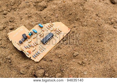 Broken Circuit Board On Sand