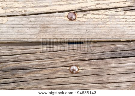 Metal Rivets In Old Cracked Wood