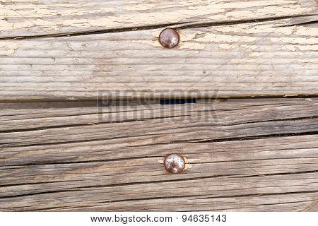 Metal Rivets In Old Cracked Wood