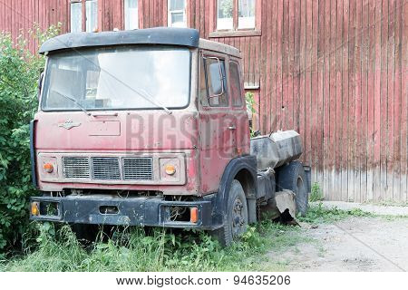 Old MAZ Lorry And Derelict House