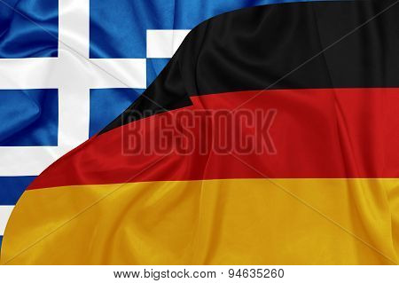Greece and Germany flags on silk texture
