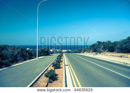 Empty Road, Sea In Background