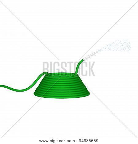 Garden hose in green design squirts water