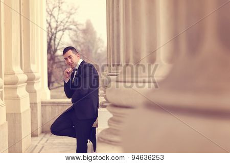 Groom Posing Near Architectures