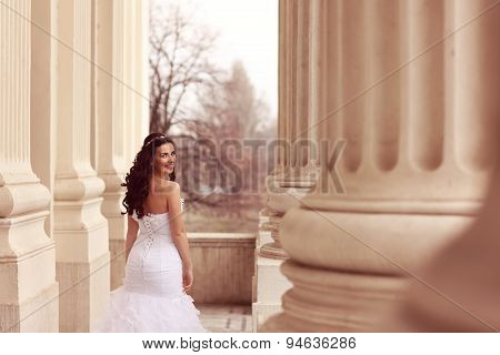 Bride Posing In Architectural Place