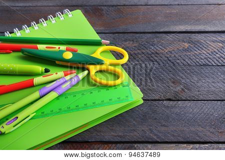 Colorful stationery on wooden table, closeup