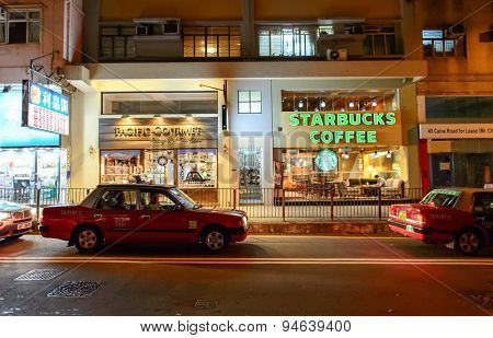 HONG KONG - JUNE 03, 2015: Starbucks Cafe interior. Starbucks Corporation is an American global coffee company and coffeehouse chain based in Seattle, Washington