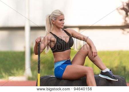Healthy Young Woman Resting After Exercise