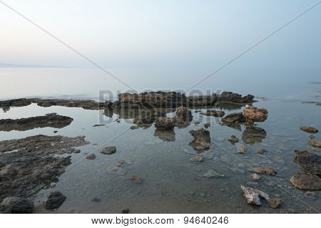 Sandstone Rocks In The Shallow Sea Watters On A Misty Evening