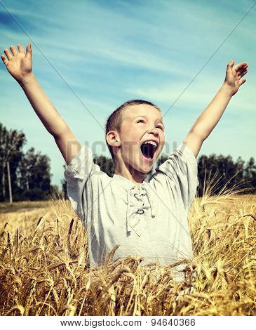 Kid In The Wheat Field