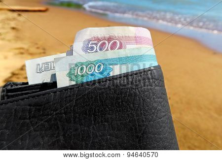 Wallet On The Seaside Background