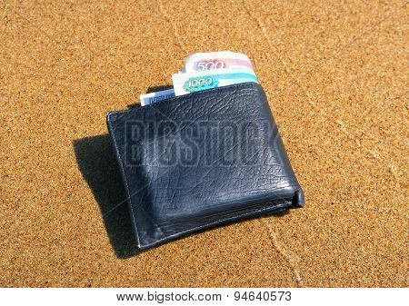Wallet On The Sand