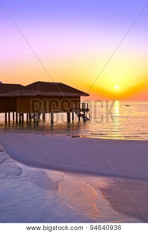 Water bungalows on Maldives island - nature travel background