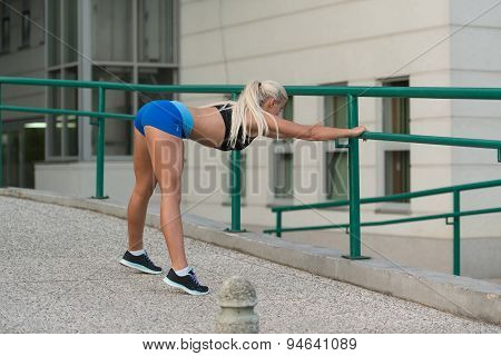 Young Woman Is Streching Outdoors