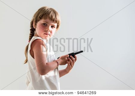 Small Girl Using Walkie-talkie