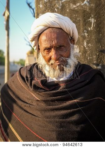 GODWAR REGION, INDIA - 14 FEBRUARY 2015: Elderly tribesman with white turban and dark blanket. Rabari or Rewari are an Indian community in the state of Gujarat.