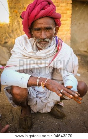 GODWAR REGION, INDIA - 14 FEBRUARY 2015: Elderly Rabari tribesman with red turban and blanket around the shoulders. Rabari or Rewari are an Indian community in the state of Gujarat.