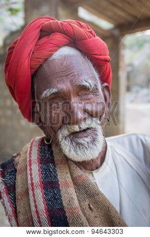 GODWAR REGION, INDIA - 13 FEBRUARY 2015: Blind Rabari tribesman holds stick in courtyard. Rabari or Rewari are an Indian community in the state of Gujarat.