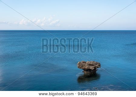 Lonely Rock In The Middle Of Blue Sea